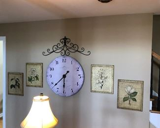 Large wall clock and floral wall art