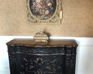 Black and wood cabinet , tapestry