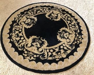 Large round black rug