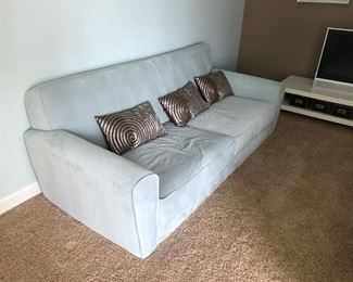 Pair of Teal 2 cushion Sofa / Couches with decor pillows and matching art, as is