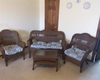 All weather 4 piece wicker set- loveseat, 2 chairs, and coffee table