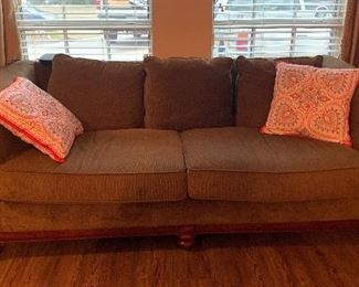 Upholstered sofa with wood trim