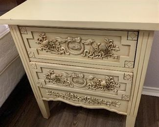 Ornate night stand with drawers