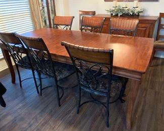 Dining table with leaf, and six metal and wood dining chairs