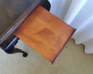 Queen Anne Mahogany Tea Table with pull out candle slide ends.