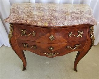 2 drawerCentury Louis XV Style Marquetry Commode with Ormolu Mounts and Marble top, stamped (incised) J. B. Moreau and a fleur de lis & five point star