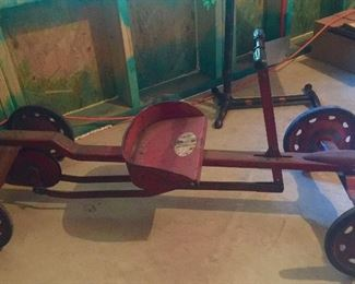 WOW- yes American pickers found one too- it's a vintage Irish metal push cart. It still works, and yes, occasionally I hop on and ride it.