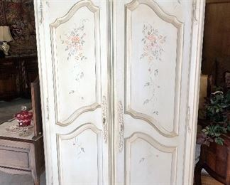 Ethan Allen hand painted armoire. Has 2 shelves inside and lots of drawer space. Plenty of space to hide a TV.        21l x 16w x 80h