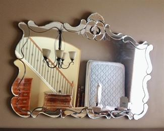 Impeccable antique  Venetian beveled mirror. I bought this at an auction, had it repainted on sides and is in perfect shape. Not sure of age it it's an oldie. One of a kind.