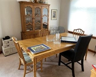 There are 4 matching chairs with table.