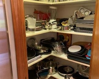 Many pots and pans and appliances.