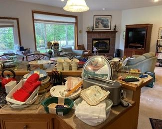 Kitchen is filled with many serving dishes, baking, appliances .Many never used.