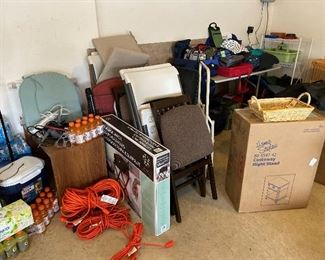 Garage. Many never-used tables, chairs, luggage.