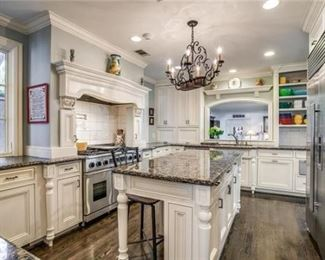 """Full kitchen with 48"""" Sub Zero,  Two Sub Zero Refrigerator Drawers, 48"""" Dacor Gas Range with Two Ovens, KitchenAid Dishwasher, Decor Warming Drawer,  Pot Filler, White Cabinetry, Granite, Island, Full Sink & Faucet, Bar Sink & Faucet and Vent Hood."""