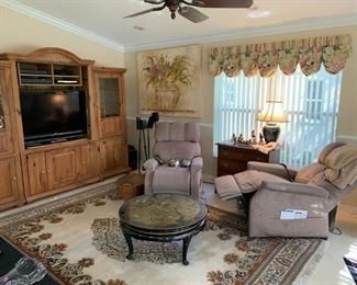 Matching Pride lift/recliner massage chairs.  White washed pine entertainment center.  Asian style coffee table.  8'x11' Open Field w/ Central Medallion Persian rug,