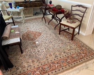 Oriental rug, leather top side tables on casters