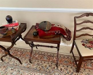 Leather top side tables on casters, needlepoint chair, etc.