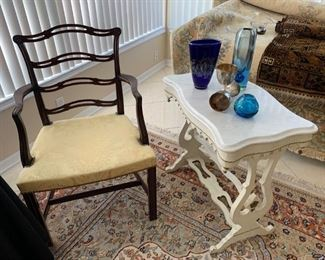 White marble top side table, vintage arm chair