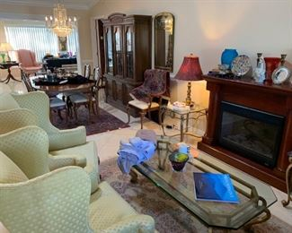 Electric fireplace, brass & glass coffee table & end tables, Stiffel table lamps, Drexel hutch, Thomasville dining room table, leaf, pads, 2 arm & 4 side chairs.