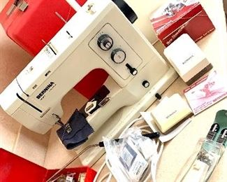 Bernina Sewing Machine with large amount of of various feet attachments