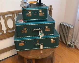 Love these charming peacock blue- teal-ish vintage luggage pieces! Displayed with fabulous vintage hairdryers!