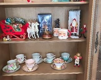 Beautiful tea cup coll. - mixed with some vintage Christmas! How fun would it be to have a little girls tea party with these sweet tea cups!