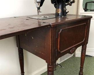 Knee operated sewing machine