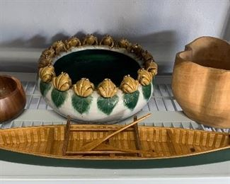 The green canoe and the frog rimmed bowl are sold.