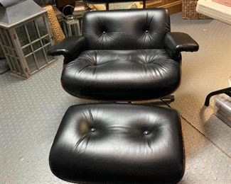Eames style chair and ottoman in Black by Selig.