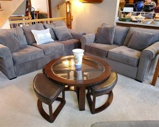 Matching, Sofa & Love seat, excellent condition, also matching chair and ottoman. Coffee table w/ extra benches/seating