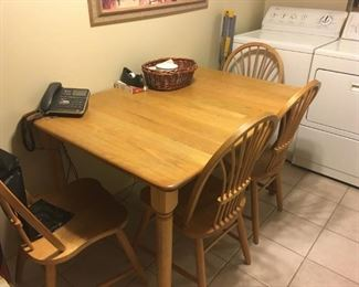 This is a nice solid oak kitchen table and four chairs -- good quality.