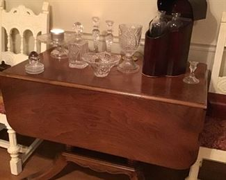 Beautiful drop leaf table, assorted Waterford crystal.