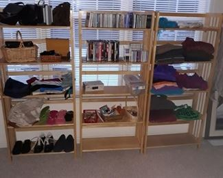 Folding wood shelf units, womens  clothes, cds and dvds