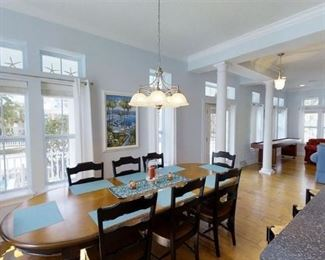 Dining room table with 8 chairs, and wall art