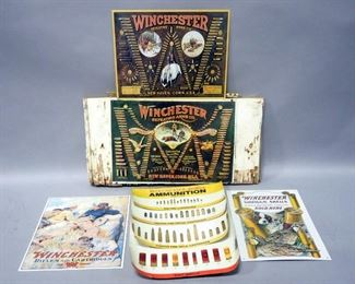 Four Winchester Tin Advertising Signs, One Is Relief And Mounted On A Board And A Winchester Ammunition Identification Flip Chart