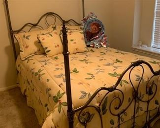 Metal queen bed frame with mattress and box spring.