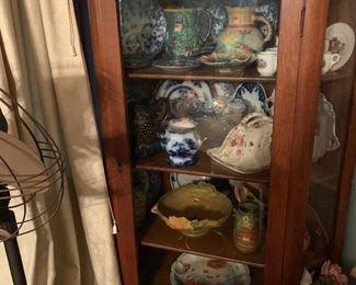 Oak china cabinet full of treasures