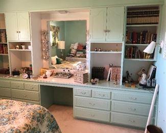Vintage books, cameras, dresser set, and other collectibles.
