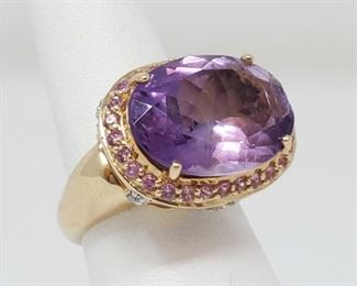 50: 14k Amethyst Oval Mixed Cut Ring w Diamonds and Pink Sapphires, 6.5 Appraised Over $3000 Size Approximately 6.5 weighs approx 8.4g Includes AIG Gem Laboratory Certificate. 1 Amethyst- Oval Mixed Cut 28 Pink Sapphire- Round Mix Cut 20 Diamonds- Round Brilliant Cut. Appraised Price $3,039.00 US