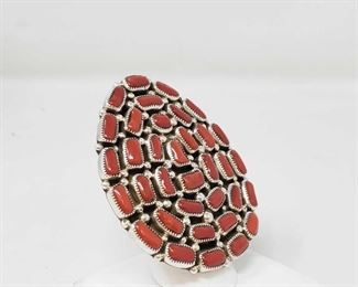 """106: MUSEUM HUGE BIG WIDE NAVAJO CORAL STERLING SILVER NATIVE AMERICAN RING This is a tremendous vintage Navajo coral silver ring. This is one of the biggest and best coral rings we have collected this year as it consists of 35 chunky and large coral stones that are in a unique and beautiful formation. Surrounding the stones are impressive silver raindrops. The shape of the ring face is a beautiful egg shape. I absolutely love that the shank on this ring is adjustable by simply squeezing together or pulling apart the shank. As is the ring measures to be a size 8-1/2. Located on the back of the ring are incredible silver stampings including geometric works, dotted patterns and bordering sun stampings. The stones measure around 1/4"""" x 1/8"""". The ring face measures around 2-3/8"""" x 2"""". Signed by Navajo artist, Merrill House . The ring size is around 8.5. Cir. 1970's+. Sterling silver, marked. Sturdy 35 grams. Value $800-$1200.00"""