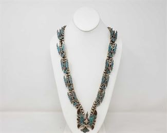 108: SPECTACULAR NATIVE AMERICAN STERLING SILVER TURQUOISE CORAL CHIP INLAY PEYOTE BIRDS SQUASH BLOSSOM SPECTACULAR NATIVE AMERICAN STERLING SILVER TURQUOISE AND CORAL CHIP INLAY PEYOTE BIRDS SQUASH BLOSSOM NECKLACE HANDMADE Value 1500-2500.00 approx 207.5g and measures approx 30 inches.