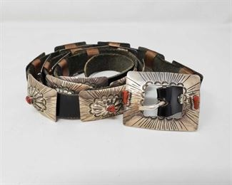 300: 300: Native American Handmade marked Sterling Silver Concho Belt with Red Coral stones Concho Belt has 15 conhos. Can be adjusted to fit any waist. Measures Approximately 40in. This belt is one of a kind !! Value 2500.00-3000.00