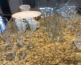 many sets of beautiful glasses and pottery