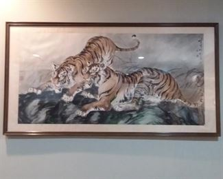 Unique Oriental framed art of a pair of Tigers. Comes with professional appraisal documents. The frame is 84 inches long x 44 inches wide x 1.75 inches deep. It is mounted on the wall going down the steps.  Please ask for assistance from one our uniformed staff if you're interested in purchasing it.