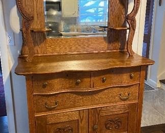Oak buffet with beveled mirror. Two piece knockdown. Mirror is original with some fading. Original owner.  Reduced to $225 no other discount.