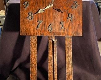 Mission oak wall clock with metal numbers and brass pendulum. Does chime but needs something fixed . No key - $65