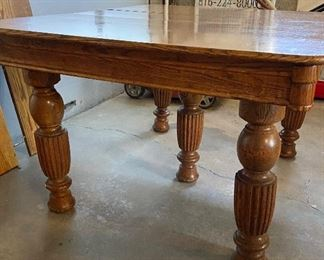 Oak 5 legged dining room table with two leaf extensions - $75