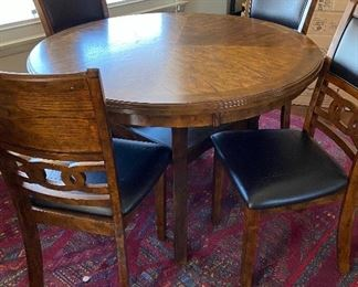 Contemporary wood table and 4 chairs. Bought new 2 years ago from Brown's Furniture ($450) - asking $250, does have some minor flaws on seats from cat but will throw in 4 new seat covers.
