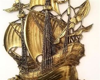 Brass base relief of a Spanish galleon