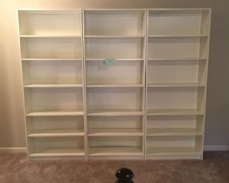 Three White Pressed Wood Bookshelves